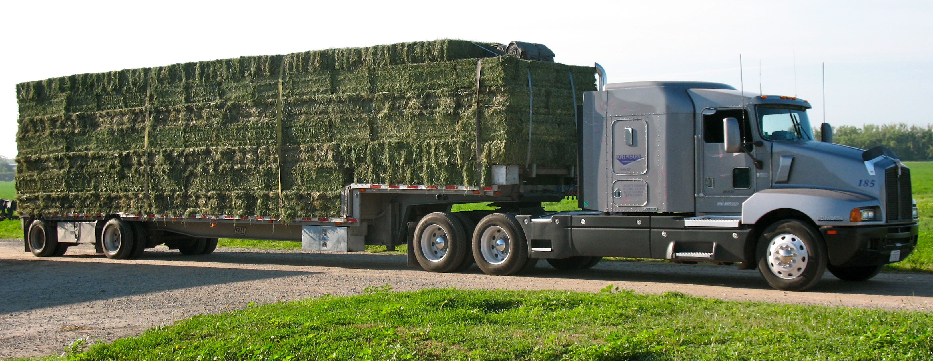 flatbed-truck-loaded-alfalfa-bales